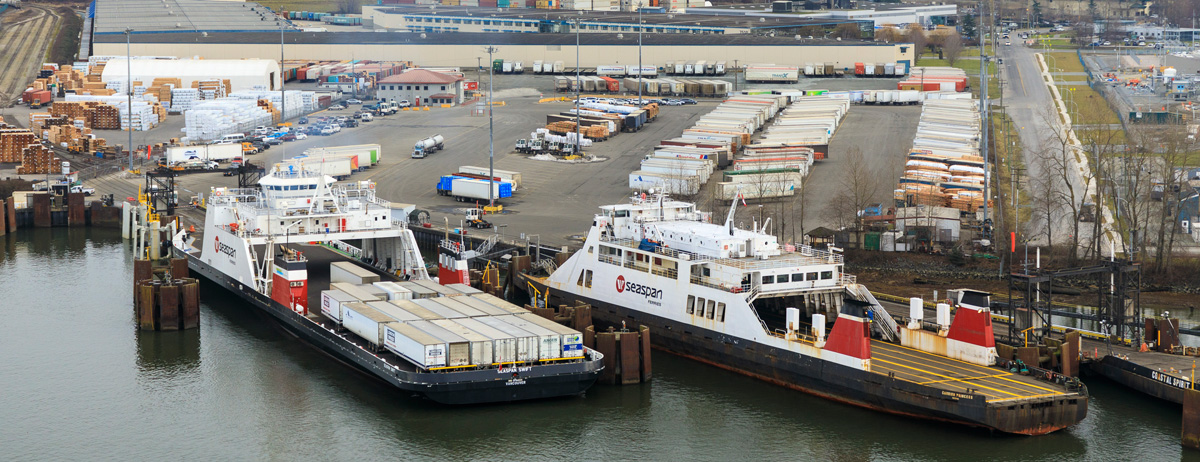 Seaspan Swift and Reliant VARD 6 515 trailer ferries design by Vard Marine docking and unloading trailers at port
