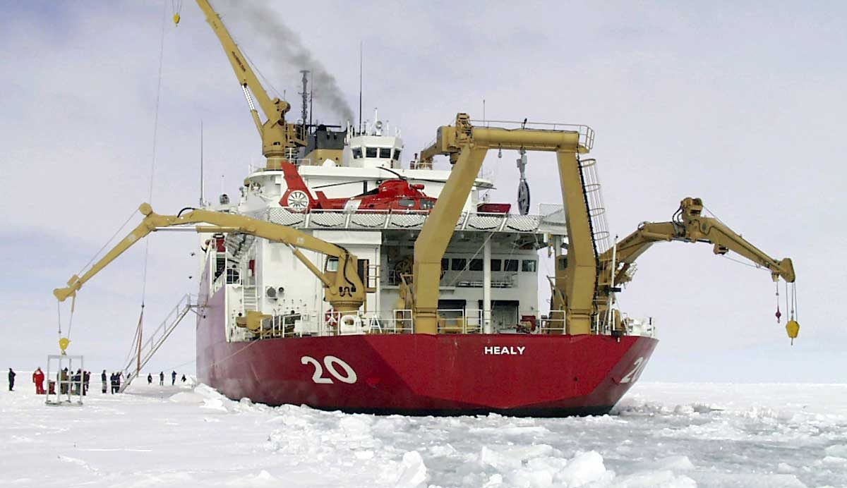 United States Coast Guard Cutter Healy icebreaker operating five cranes in the Sea of Labrador