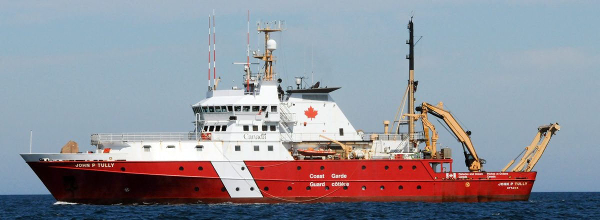 Canadian Coast Guard CCGS John P. Tully offshore oceanographic/research science vessel in calm waters