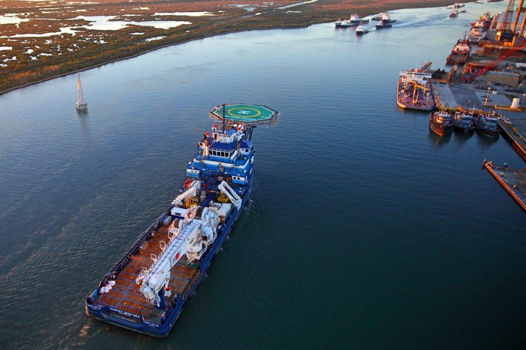 Offshore Construction Vessel (OCV) VARD 3 310 Harvey Deep-Sea Multi-Purpose Support Vessel MPSV sailing past a port