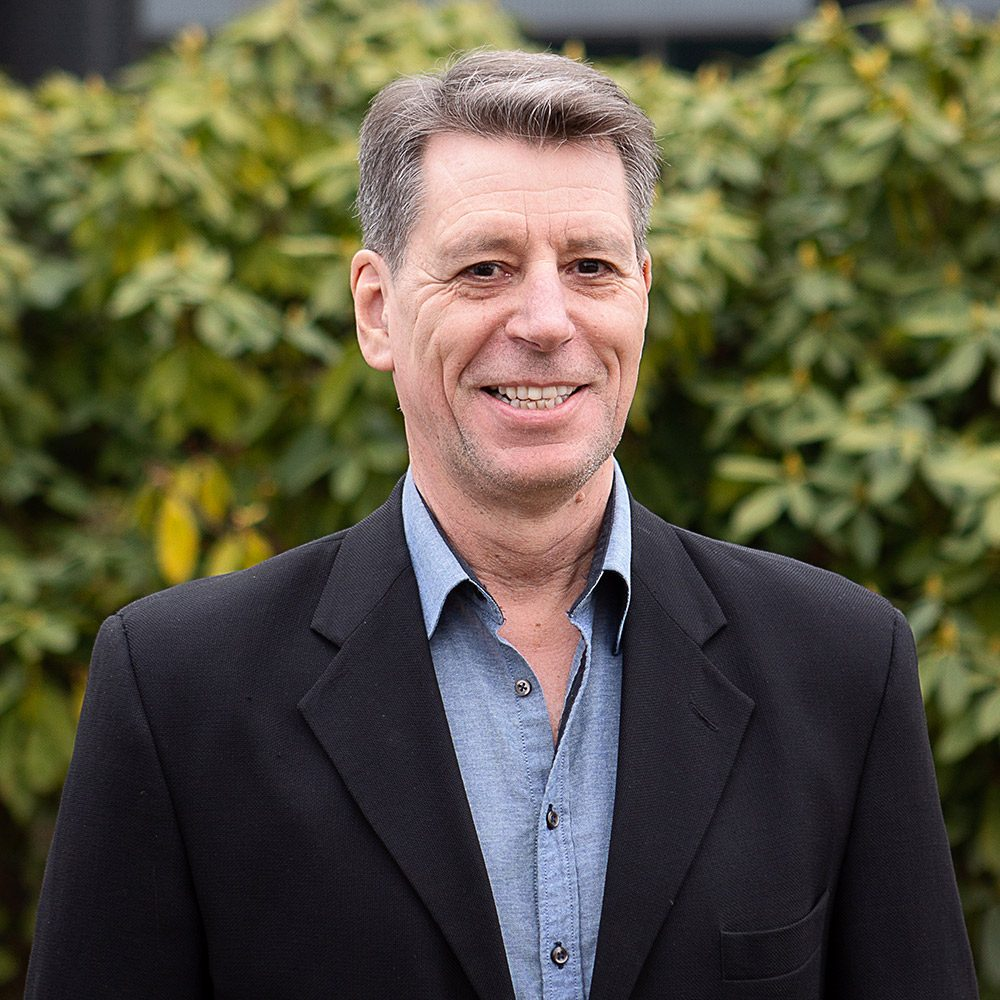 Mark Cook, COO/Vice President Vancouver Vard Marine in black blazer and blue shirt